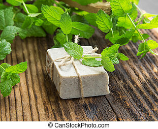 Herbal handmade soap with mint leaves