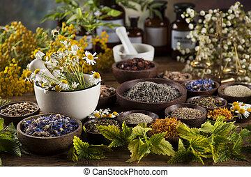 Fresh medicinal, healing herbs on wooden