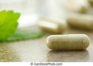 Herbal medicine - Close up of herbal medicine in capsules