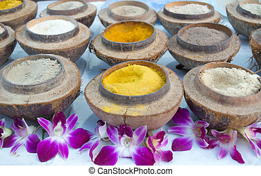 Herbal powder for Spa in coconut shell.
