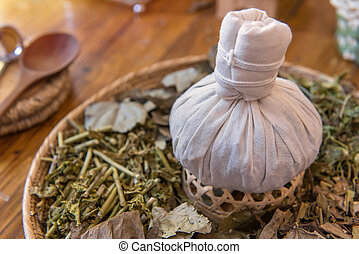 herbal spa balls for treatment or massage with herb bergamot...