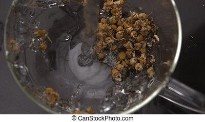 Herbal tea being prepared - Herbal tea being prepared in...