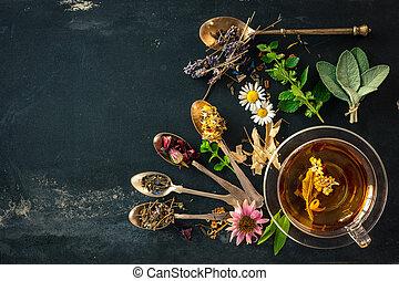 Herbal tea - Cup of herbal tea with wild flowers and various...