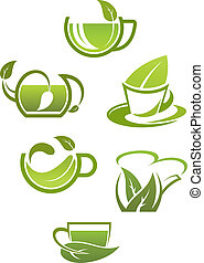 Herbal tea cups with green leaves isolated on white ...