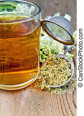 Herbal tea from meadowsweet dry in a strainer with a mug - ...