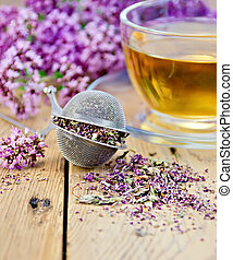 Herbal tea from oregano with strainer on board
