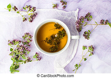 Herbal tea in a cup with flowers