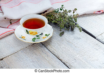 herbal tea on a white wooden background.