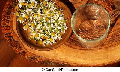 herbal tea - pouring herbal tea