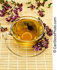 Herbal tea with oregano on bamboo
