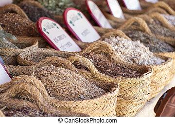 Herbal, wicker baskets stuffed medicinal healing herbs