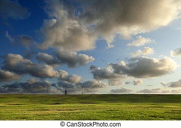 herboso, colinas, debajo, cielo dramático