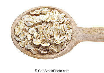 Herbs and spices on wooden spoons - oats
