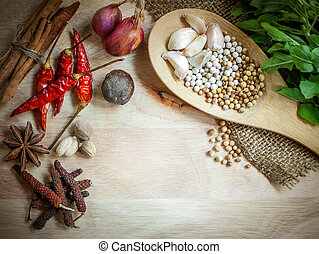 herbs and spices on wooden