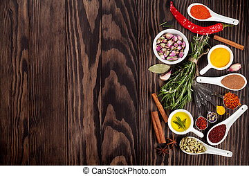 Herbs and spices over wood background