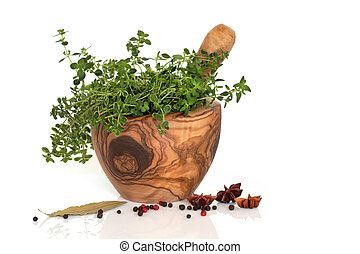 Herbs and Spices - Thyme herb leaves in an olive wood mortar...