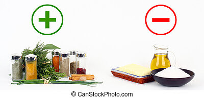 Herbs and spices versus fats and oils on white background