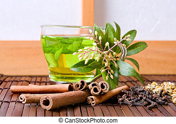 Herbs and tea - Herbs and green tea against a japanese...