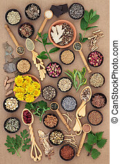 Food and herb selection used in female alternative herbal medicine over ridged brown paper background.