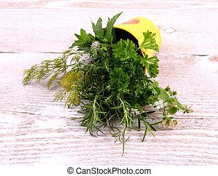 Herbs in bucket on white wooden background