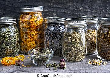 Herbs in jars - Various dried medicinal herbs and herbal...