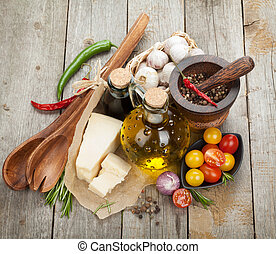 Herbs, spices and seasoning over wooden table background