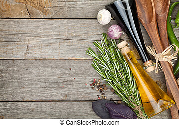 Herbs, spices and seasoning with utensils over wooden table ...