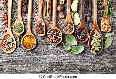 Herbs with spices on a wooden background
