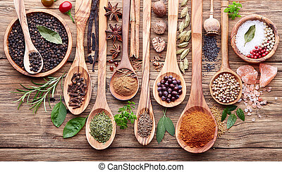 Herbs with spices on a wooden board