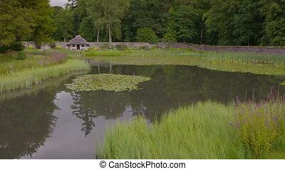 Hercules Garden Pond and Bird House, Scotland, UK - Wide low...