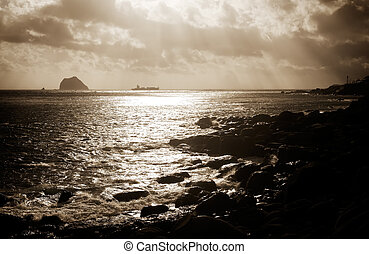 a boat on the sea with strong light effect