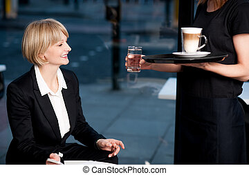 Here is what you ordered ma'am! - Middle aged businesswoman...