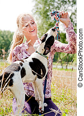 Here is your toy - Blond girl and a american bulldog in the...