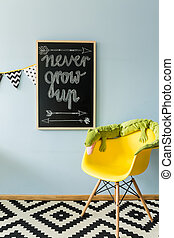 Here's my new motto - Shot of a blackboard and a chair with...