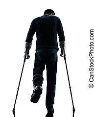 herido, muletas, ambulante, silueta, hombre, vista trasera