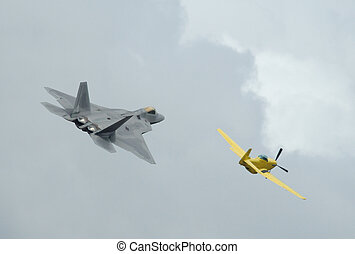 Heritage flight with F-22 Raptor and a P-51 Mustang - Arctic...