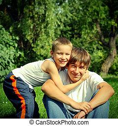 hermanos, en el parque