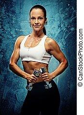 hermoso, atleta, mujer, con, dumbbells.
