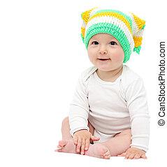 hermoso, feliz, bebé, chico que sienta, blanco, cama