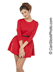 hermoso, joven, hembra, en, vestido rojo, posición, posar