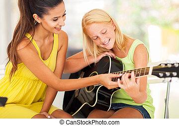 hermoso, juego, joven, guitarra, música, niña, dar clases ...