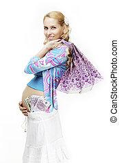 hermoso, mujer embarazada, con, compras, y, dinero