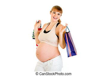 hermoso, mujer embarazada, tenencia, bolsas de compras, en, manos, aislado, blanco