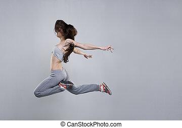 hermoso, mujer joven, bailarín, saltar hacia dentro, estudio