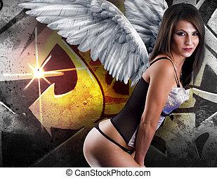 hermoso, mujer joven, con, blanco, alas, contra, grafiti, plano de fondo, con, intenso, luz anaranjada