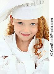 hermoso, niña joven, niño, en, chef, uniforme, y, sombrero