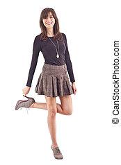 hermoso, niña, posar, en, cortocircuito, skirt.
