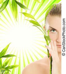 hermoso, planta, mujer, encima, joven, fondo verde, bambú, ...