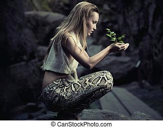 hermoso, planta, mujer, joven, tenencia