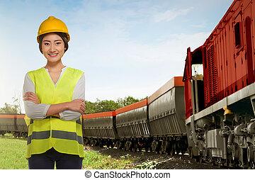 hermoso, posición, mujer, al lado de, tren, asiático, carga, Empleado, ferrocarril